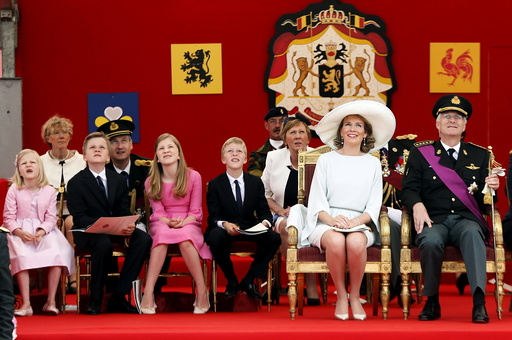 Belgium's King Philippe and Queen Mathilde watch the traditional military parade with their children in front of the Royal Palace in Brussels