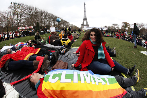 near the Eiffel Tower in Paris as the World Climate Change Conference 2015 (COP21) continues near the French capital in Le Bourget