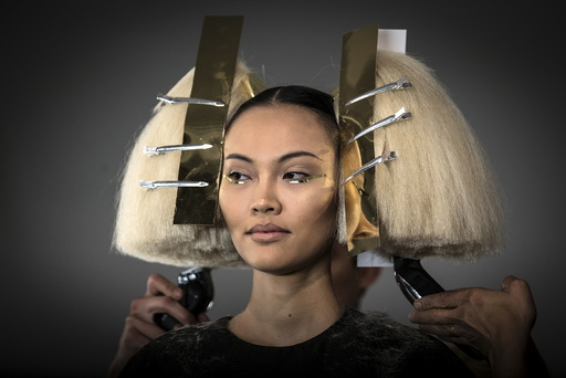 A model has her hair done before The Blonds Spring/Summer 2016 collection during New York Fashion Week