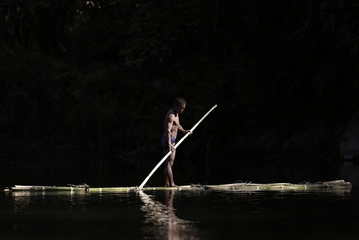 A Naga man manoeuvres a raft made of bamboo between Donhe and Lahe township in the Naga Self-Administered Zone