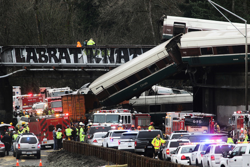 First responders are at the scene of an Amtrak passenger train which derailed and is hanging from a bridge over the I-5 in DuPont