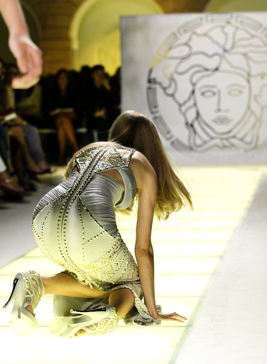 A model falls as she displays a creation as part of Versace Spring/Summer 2012 women's collection during Milan Fashion Week
