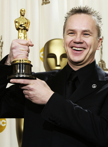 TIM ROBBINS HOLDS UP BEST SUPPORTING ACTOR OSCAR