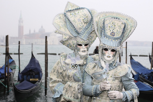 Masked reveller pose in San Marco Piazza during the Venice Carnival