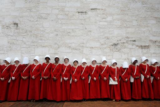 Women dressed as handmaids promoting the Hulu original series