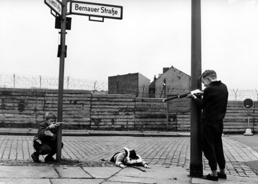 Children play in front of Berlin Wall in Bernauer Street
