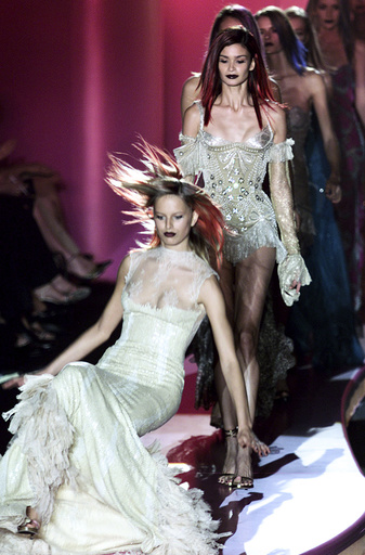 A MODEL FALLS TO THE CATWALK AT VERSACE AUTUMN-WINTER 2002/2003 COLLECTION IN PARIS.