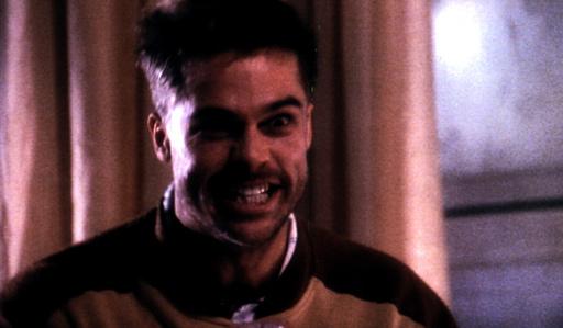 TWELVE MONKEYS, Brad Pitt, 1995, looking demonic