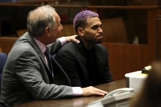 Singer Brown appears in court with his lawyer Mark Geragos for a progress hearing in Los Angeles, California