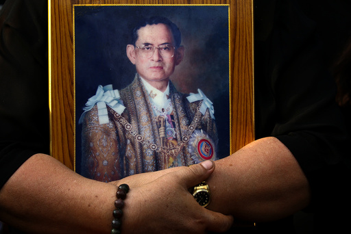 A mourner holds a portrait of Thailand's late King Bhumibol Adulyadej in Bangkok