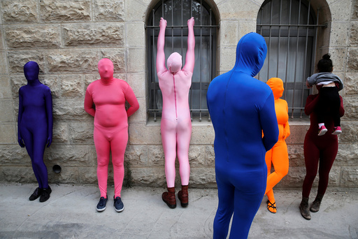 Members of the Prizma Ensemble wearing full solid-coloured bodysuits take part in the 6th Jane's Walk Jerusalem in Jerusalem