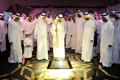 Dubai's ruler Sheikh Mohammed bin Rashid al-Maktoum lays foundation stone for a solar plant for generating clean energy in Dubai