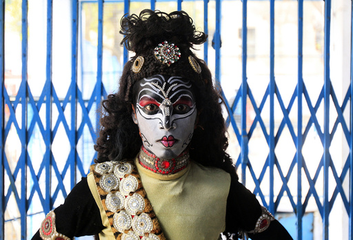 A boy dressed as Hindu Lord Shiva poses before performing in a religious procession at the Mahashivratri festival in Allahabad