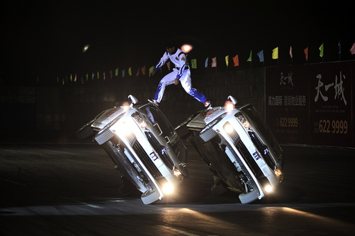 Stunt drivers perform during a drift game in Taiyuan