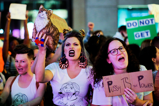 Women protest against Republican presidential nominee Donald Trump and the GOP in front of Trump Tower in Manhattan