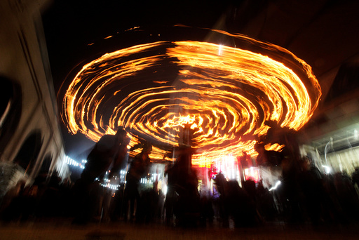 Shi'ite Muslims perform with fire during commemorations for Ashoura in Najaf