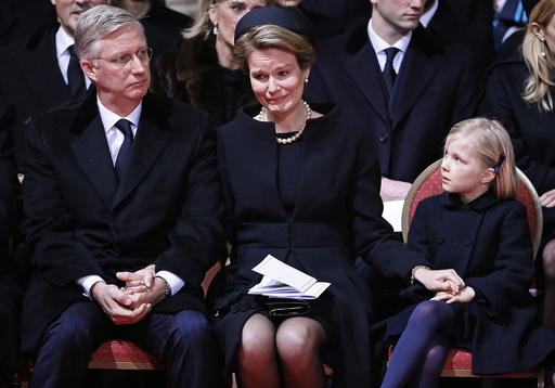 Belgium's Queen Mathilde cries while sitting besides King Philippe during a funeral service for Belgium's Queen Fabiola at Saint-Gudule cathedral in Brussels