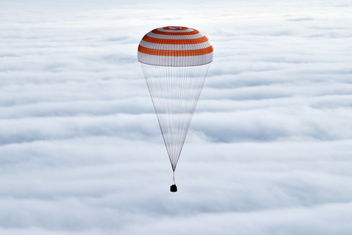 Soyuz capsule carrying International Space Station crew members descends near Dzhezkazgan