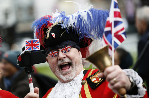 A Royal fan dressed as a Town Crier gathers to celebrate Queen Elizabeth's 90th birthday in Windsor