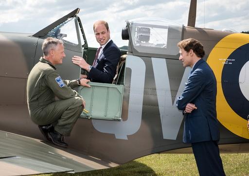 Pilot Romain and philanthropist Kaplan speak to Britain's Prince William during his visit to the Imperial War Museum in Duxford