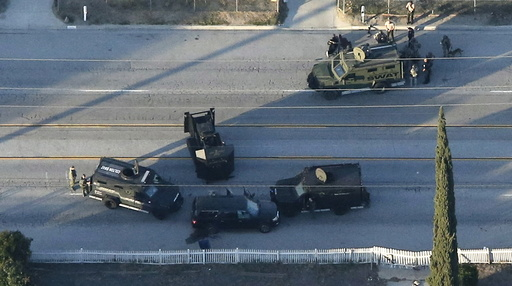 Aerial photo of an SUV with its windows shot out that police suspect was the getaway vehicle from at the scene of a shooting in San Bernardino, California