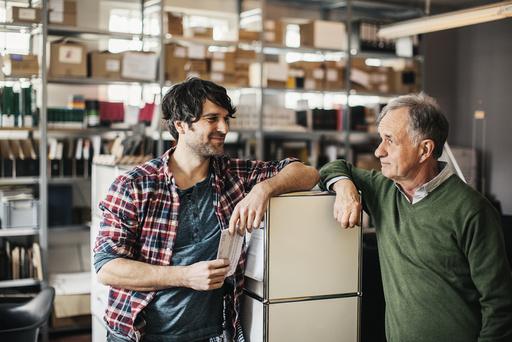 Two men in printing shop