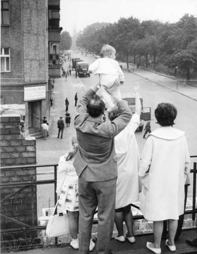 Families wave at each other across Berlin Wall