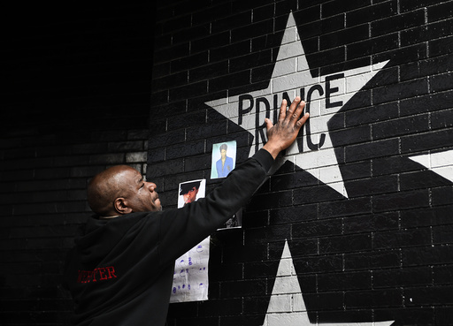 Donnie Straub of Minneapolis touches a star bearing U.S. music superstar Prince's name on an exterior wall of First Avenue in Minneapolis Minnesota