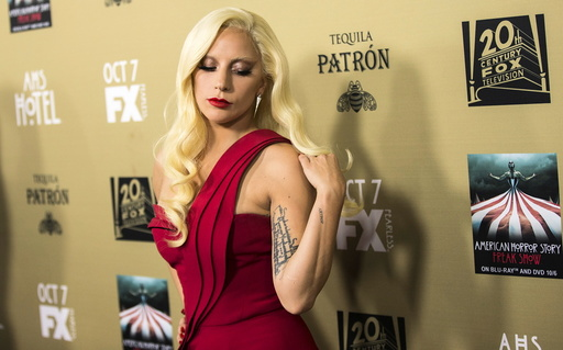 Cast member Lady Gaga poses at a premiere screening of
