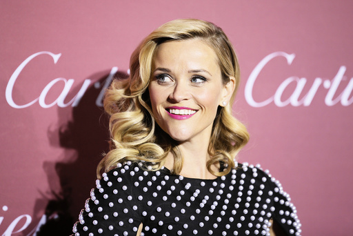 Actress Reese Witherspoon, who is receiving the Chairman's Award, poses at the 26th Annual Palm Springs International Film Festival Awards Gala in Palm Springs