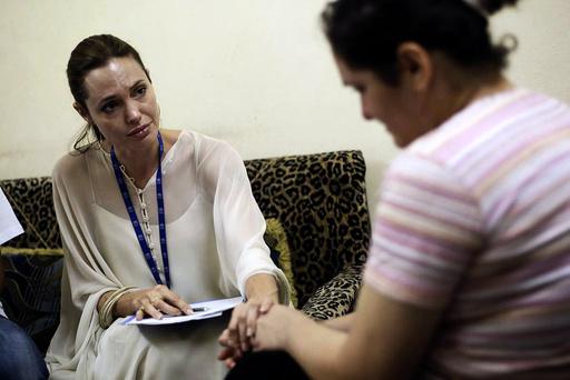 UNHCR Goodwill Ambassador Angelina Jolie listens as an Iraqi refugee woman talks about her experience in Iraq, in Jaramana
