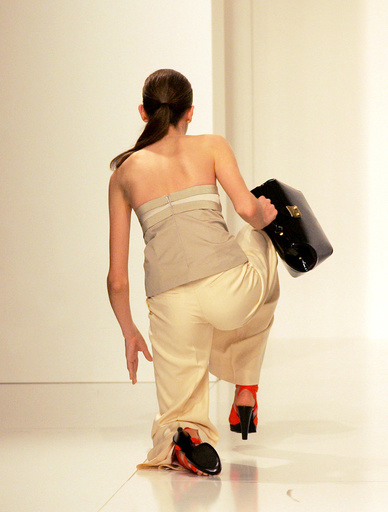Model falls down during the fashion show trademark Forum, summer collection during the Sao Paulo Fashion Week