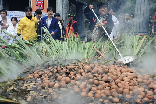 More than a thousand eggs are boiled with spices in a pot during a