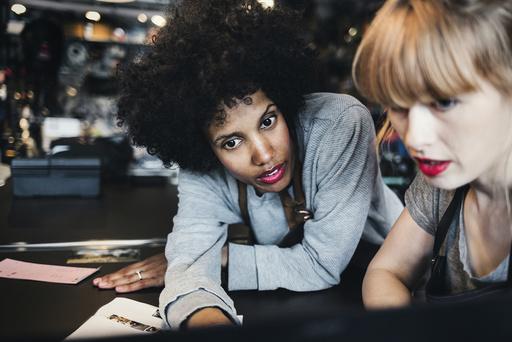 Female mechanics using laptop in workshop