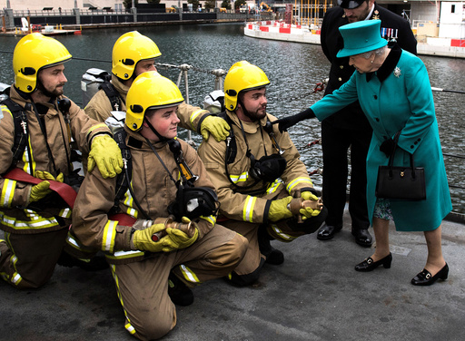 Britain's Queen Elizabeth II visits HMS Sutherland in the West India Dock, London