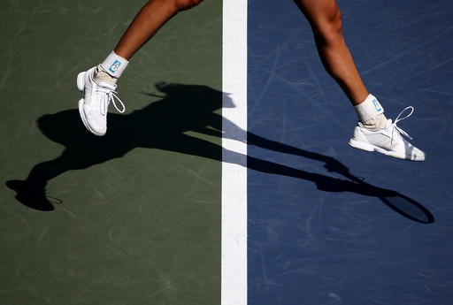 Muguruza of Spain casts a shadow as she serves to Strycova of the Czech Republic during their Pan Pacific Open women's singles tennis match in Tokyo