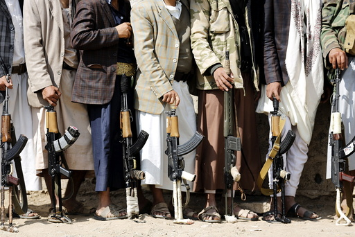 Tribesmen loyal to the Houthi movement hold their weapons at a gathering to show their support for the group, in Yemen's capital Sanaa