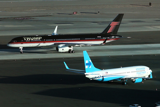 U.S. Republican presidential nominee Trump's campaign plane passes U.S. Democratic presidential nominee Clinton's campaign plane as it lands in Las Vegas