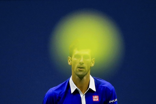 Djokovic of Serbia follows the flight of his ball as he returns to Federer of Switzerland during their men's singles final match at the U.S. Open Championships tennis tournament in New York