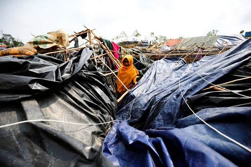 Ayesha, a Rohingya refugee girl poses for photograph in her house which has been destroyed by Cyclone Mora at Balukhali Makeshift Refugee Camp in Coxâä™s Bazar