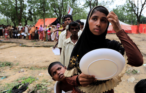 Rohingya refugees line up to get food from Turkish Cooperation and Coordination Agency (TIKA) near Balukhali refugees camp near Cox's Bazar