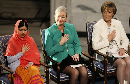 Nobel Peace Prize laureate Yousafzai reacts next to Norwegian Nobel committee members Kullman-Five and Marie during the Nobel Peace Prize awards ceremony at the City Hall in Oslo