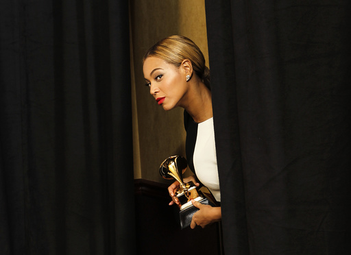 Beyonce looks out at photographers as she comes backstage with her award for Best Traditional R&B Performance at the 55th annual Grammy Awards in Los Angeles