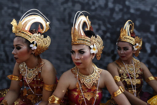 Participants from Indonesia wait to perform a dance during the last day of World Culture Festival on the banks of the river Yamuna in New Delhi
