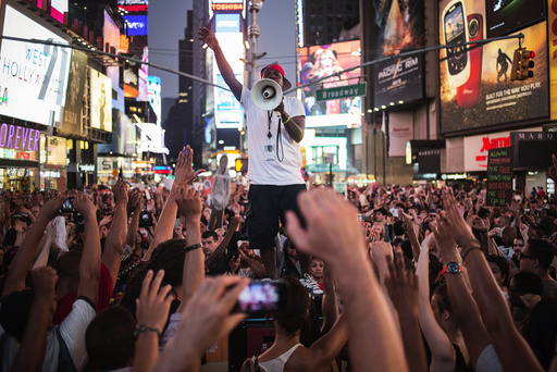 Activists demand justice for Trayvon Martin after marching to Times Square from New York's Union Square