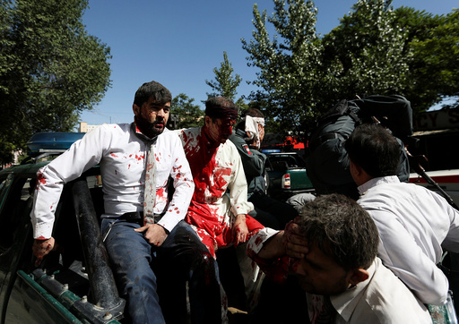 Injured men arrive to a hospital after a blast in Kabul, Afghanistan