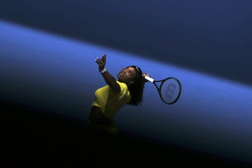 Williams of the U.S. serves during her first round match against Italy's Giorgi at the Australian Open tennis tournament at Melbourne Park, Australia