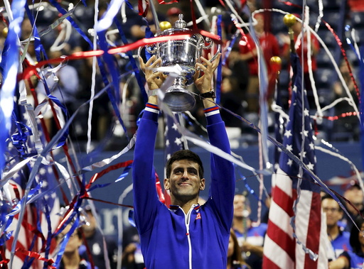 Djokovic of Serbia holds up the U.S. Open trophy after defeating Federer of Switzerland in their men's singles final match at the U.S. Open Championships tennis tournament in New York
