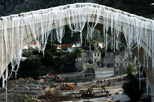 Workers prepare Mostar's oriental old town for opening ceremony of 16th century replica bridge
