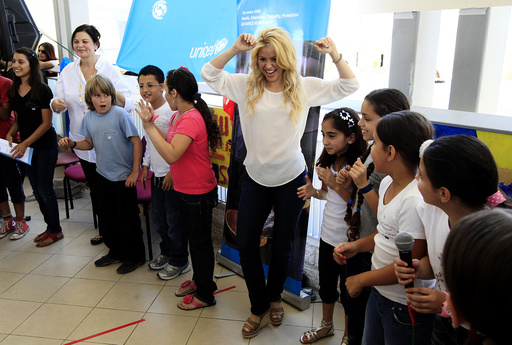 Colombian pop star and UNICEF ambassador, Shakira, dances with children from the Max Payne Hand in Hand School for Bilingual Education during her visit to the school in Jerusalem